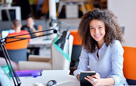 smiling corporate woman working in an office