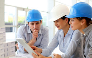 three people with hardhat in office