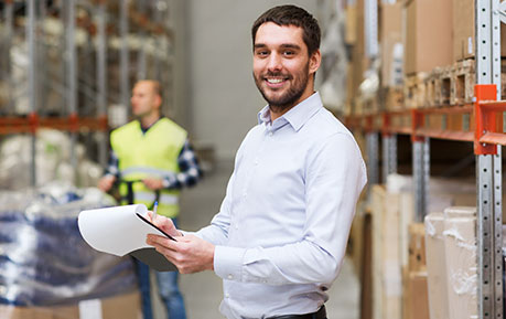 man with clipboard in warehouse